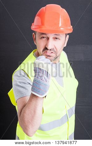 Angry Male Constructor Showing Fist And Looking Irritated