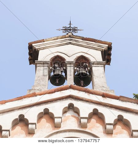 Small bell tower with a bell of a church .