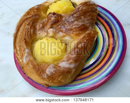 Danish pastry with pudding on a colorful plate
