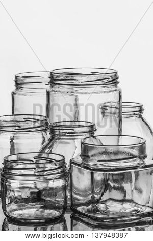 Empty glass jars for preserves pickles or jam.