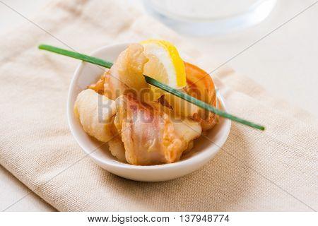 A plate of fried calamari rings Italian style.
