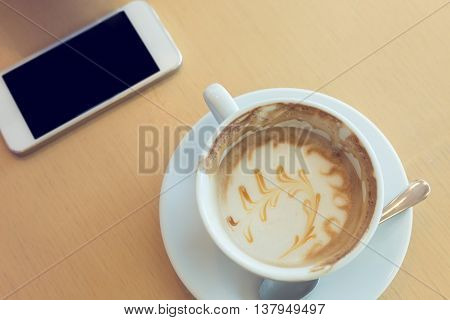 Caramel Macchiato Coffee And Mobile Phone In Cafe Coffee