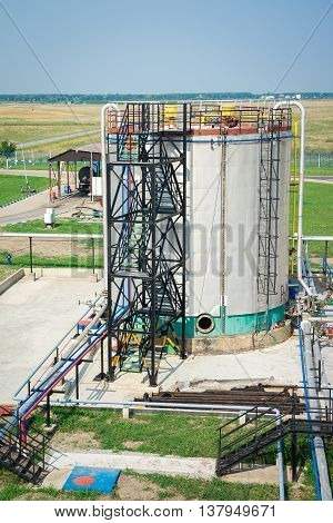 Gas tank in oil Processing Plant on the blue sky