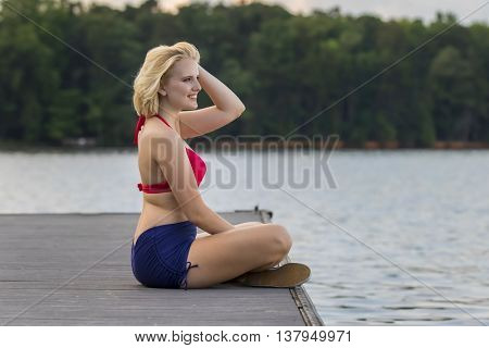 A young blonde model celebrating the fourth of July in an outdoor environment
