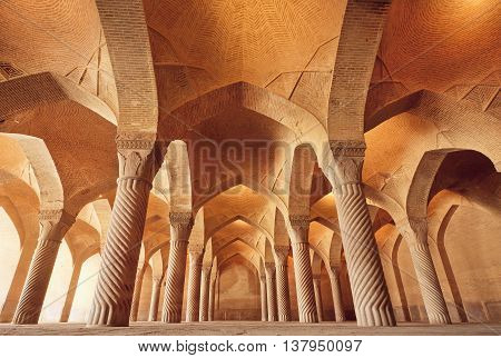 Persian mosque Vakil with carved columns in huge historical hall built at 1773 in Shiraz, Iran