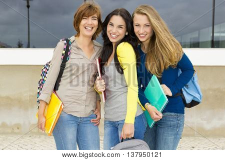 Happy group of students in the school