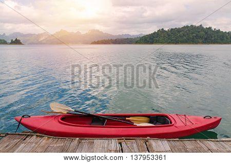 Floating Red Canoe In Ratchaprapha Dam At Khao Sok National Park, Thailand