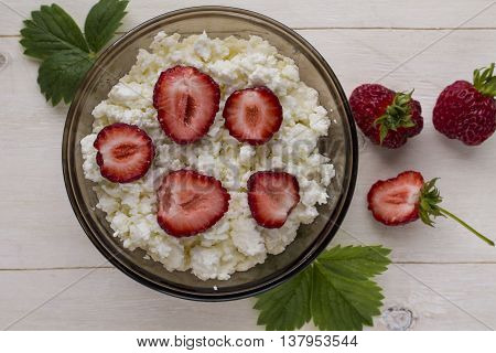 cottage cheese with ripe berries,wild strawberries and honeysuckle, and mint leaves