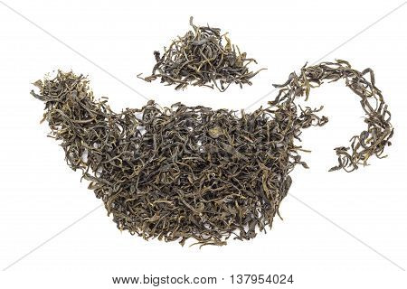 Teapot shape made of organic Green Tea (Camellia sinensis) dried long leaves. Isolated on white background. Top view.