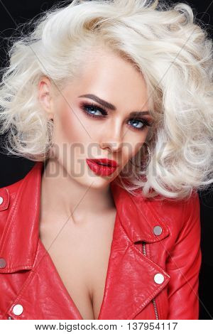 Portrait of young beautiful sexy stylish  blonde woman in red leather jacket