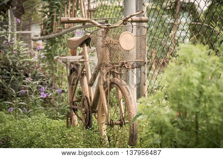Old bicycle in public park vintage style.