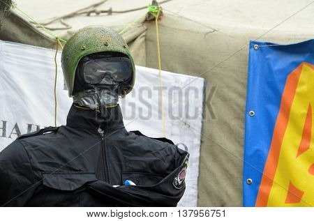 KIEV, UKRAINE - FEB 10, 2014: Downtown of Kiev.Doll wears police uniform and helmet of policeman EXECUTED in the camp of protesters. Riot in Kiev .February 10, 2014 Kiev, Ukraine