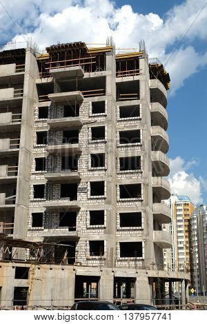 Process of modern city apartment building construction in residential district vertical photo