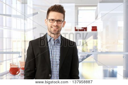 Portrait of a smiling trustworthy businessman in modern office building.