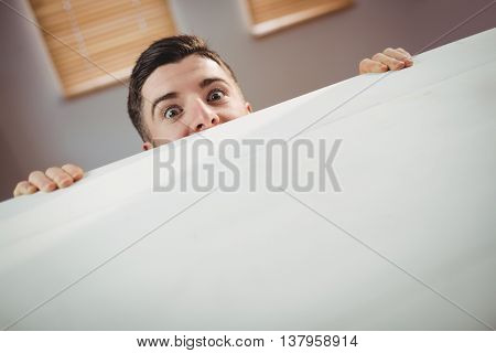Portrait of man behind table at office