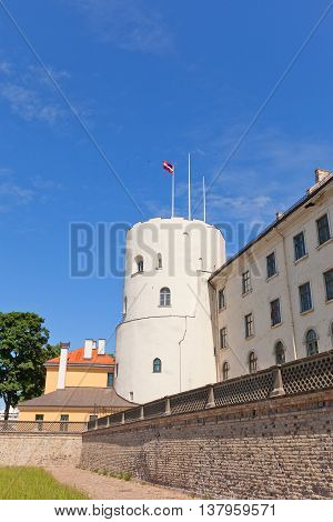 RIGA LATVIA - JUNE 7 2016: Holy Spirit Tower (circa 1515) of Riga Castle in Riga Latvia (UNESCO site). Initially constructed in 1330 for Livonian Order now castle serves as President Palace