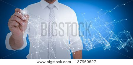 Male executive writing with marker against blue background