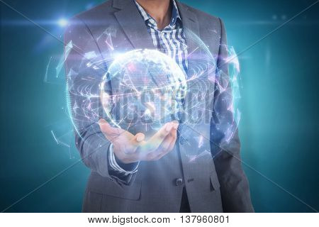 Businessman holding hand out against global technology background in purple