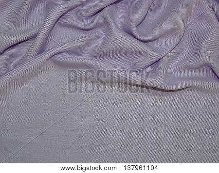 light purple cloth laid in beautiful folds, closeup