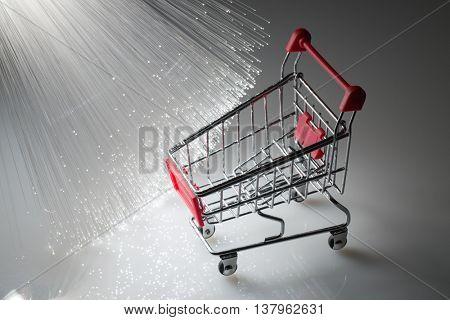 Shopping cart and Fiber optics background