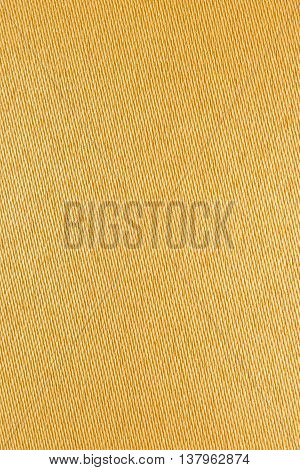 Closeup and detail on yellow fabric background or backdrop
