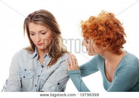 Troubled young girl comforted by her friend. Isolated on white background
