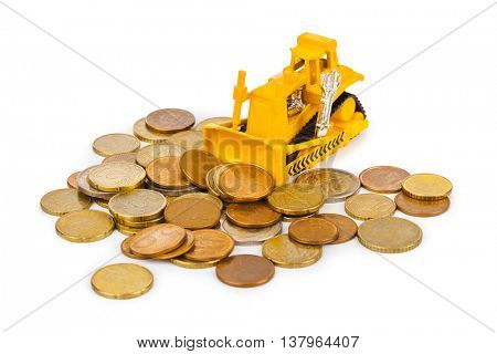Toy bulldozer and money coins isolated on white background