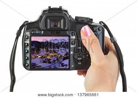 Camera in hand and winter Austria view (my photo) isolated on white background