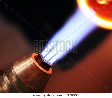 The Blue Flame Heats The Glass Bead