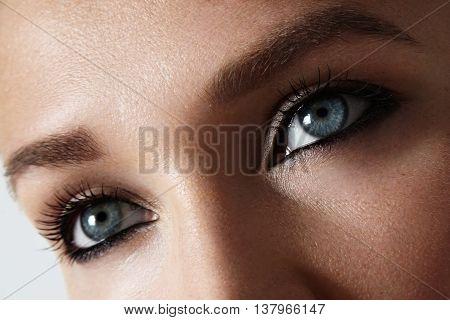 women's blue eyes closeup photo. eye surgery concept