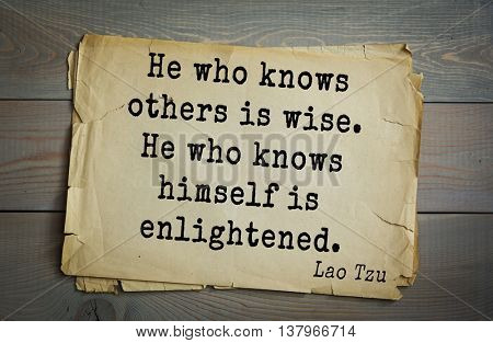 Ancient chinese philosopher Lao Tzu quote on old paper background.  He who knows others is wise. He who knows himself is enlightened.