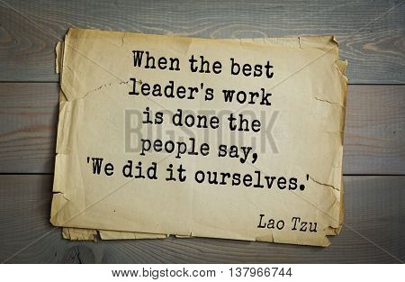 Ancient chinese philosopher Lao Tzu quote on old paper background.  When the best leader's work is done the people say, 'We did it ourselves.