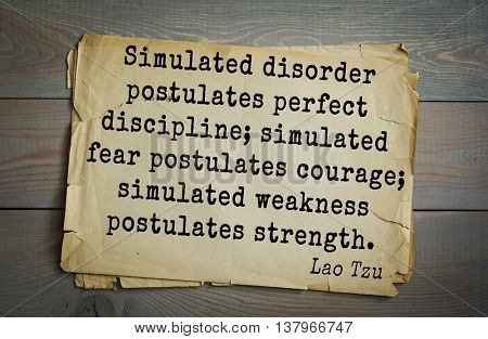 Ancient chinese philosopher Lao Tzu quote on old paper background.  Simulated disorder postulates perfect discipline; simulated fear postulates courage; simulated weakness postulates strength.