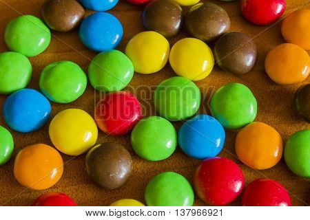 Sweet Color Chocolate Candy On Wooden Background