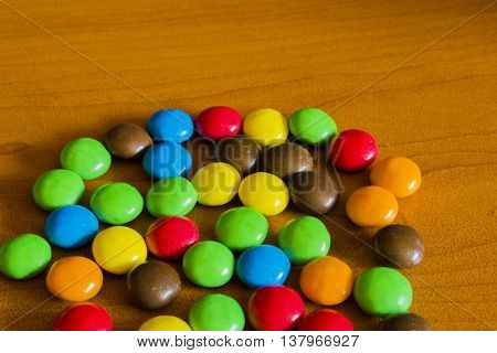 Mixed Colorful Sweet Candies On Wooden Background