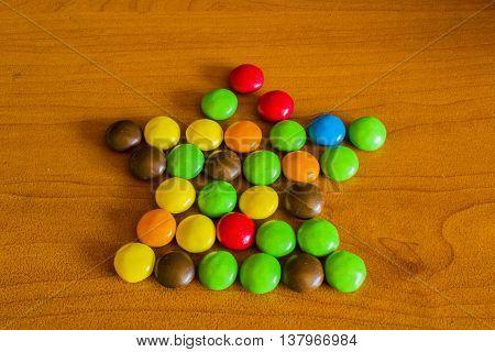 Star Sweet Color Candy On Wooden Background
