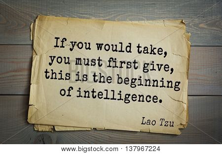 Ancient chinese philosopher Lao Tzu quote on old paper background.  If you would take, you must first give, this is the beginning of intelligence.
