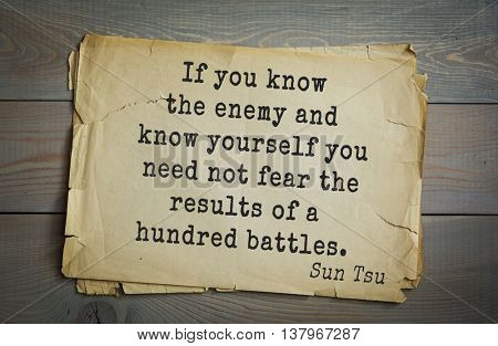 Ancient chinese strategist and philosopher Sun Tzu quote on old paper background. If you know the enemy and know yourself you need not fear the results of a hundred battles.