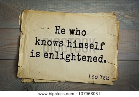 Ancient chinese philosopher Lao Tzu quote on old paper background. He who knows himself is enlightened.