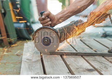 Mechanic metal cutting electric saw close-up .