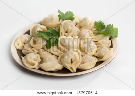 Boiled prepared homemade russian dumplings or pelmeni with beef meat on the plate