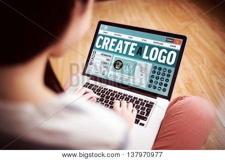 Webpage for create a logo against asian woman using laptop with copy space
