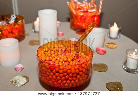 Wedding candy table setting with burning candles