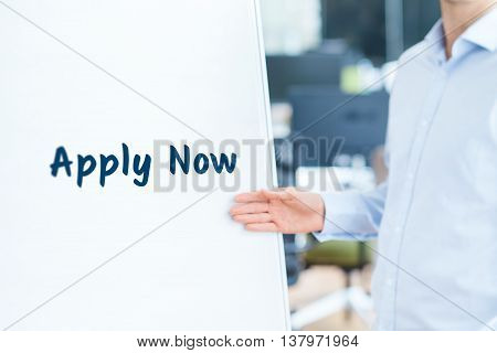 Apply now concept. Businessman (recruiter HR staffer) attract new employees on company presentation.