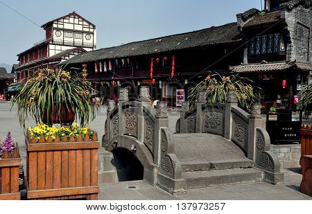Jie Zi Ancient Town China - March 6 2013: One of the small footbridges leading into the Jinyu Street main square with its distinctive wooden half-timber buildings