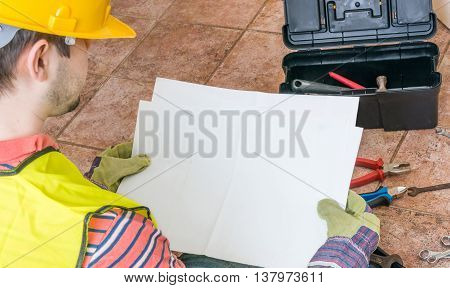 Worker Is Holding Empty Paper As A Frame For Custom Message.