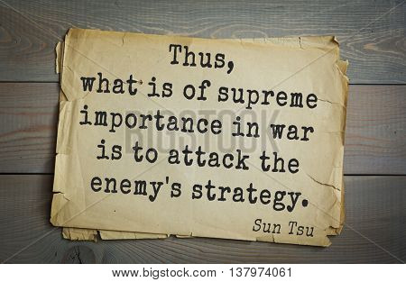 Ancient chinese strategist and philosopher Sun Tzu quote on old paper background. Thus, what is of supreme importance in war is to attack the enemy's strategy.