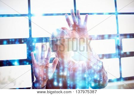 Digitally generated black and blue matrix against businessman using virtual reality device
