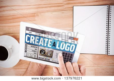 Webpage for create a logo against hands holding blank screen tablet