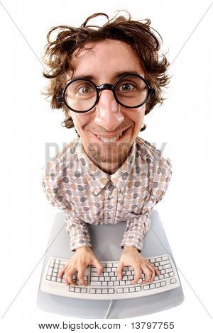 Fish-eye shot of a smiling tousled nerd typing on the keyboard